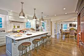kitchen island example of a classic open concept kitchen design in new york with raised panel architect gensler location san francisco california