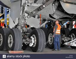 a technician has a close look at the undercarriage of an airbus a technician has a close look at the undercarriage of an airbus a380 at the airport in frankfurt main 08 2010 before lufthansa puts their