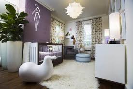 purple wall design and matching bedding accent this mostly white nursery featuring fur rug over baby nursery yellow grey gender neutral