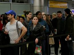 transportation security rand travelers wait in line at a security checkpoint at la guardia airport in new york city