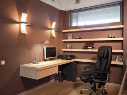 brown wall color with wooden floating l shaped desk for small office ideas with black leather ergonomic chair and ambient lighting charming office wall color ideas