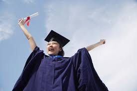 gap year taking a year off after college university student in graduation robe cheering