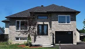 Plan W PM  Narrow Lot Split Level Home Plan   e ARCHITECTURAL    Only ′ wide  this split level home plan is designed for a narrow lot