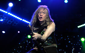 Watch <b>Iron Maiden's</b> Janick Gers lose grip of his guitar sending it ...