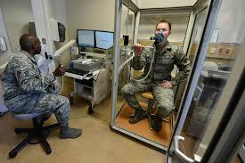 photos staff sgt ar haynes directs senior airman robert hart through a pulmonary function test jan