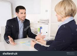 job interview meeting situation business man stock photo  job interview or meeting situation business man and w at desk