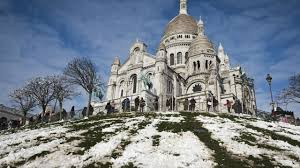 Paris gets first snowfall as snowboarders hit Montmartre's slopes