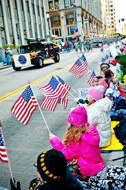 u s department of defense photo essay children wave american flags in support of veterans and military service members while iers through