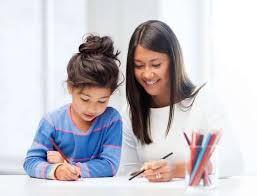 Mother Helping Daughter with Homework in Kitchen Family Education