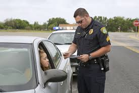 guide to becoming a police officer police officer examining license of teenage girl