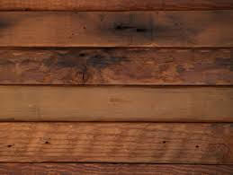 these wide plank barn boards were never exposed to the sun or rain therefore are not worn like the typical grey barn siding but aged to a perfect deep rich barn boards