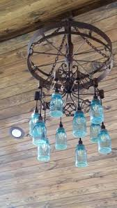 wagon wheel light with mason jars alternating length wagon wheel mason jar