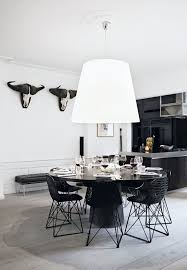 dining table interior design kitchen: elegant and modern kitchen and dining area with a round and black dining table surrounded by