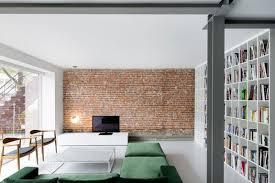 comfy gray sofa black polished wooden wall corner shelves elegant minimalist furniture style sofa sets brick brick living room furniture