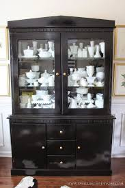 ideas china hutch decor pinterest: glossy black china cabinet with milk glass collection