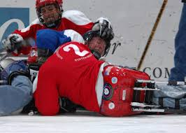 u s department of defense photo essay disabled veterans wrestle for the puck during a sled hockey game at the aspen ice rink