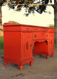love this orange burnt orange furniture