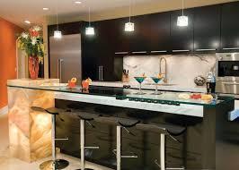 modern kitchen track lighting black wooden cabinet with white granite countertops black bar stools flower backsplash lighting