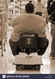 wal mart cart stock photos wal mart cart stock images alamy obese man shopping in walmart usa using a rechargeable electric cart so that he can drive