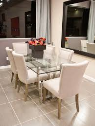 dining table parson chairs interior: modern dining room design with white parsons chairs and glass dining table and laminate tile flooring
