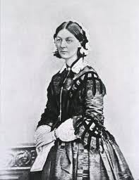 the lady who became a nurse circulating now formal portrait standing in a fine dress holding a folded paper florence nightingale
