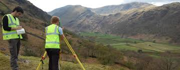 f862 geographic information science bsc undergraduate two students use equipment to survey a hilly landscape