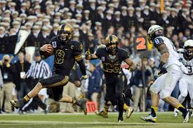 NCAA College Athletes Should Be Paid   US News Opinion US News   World Report Army     s Trent Steelman  left  runs into the end zone for a touchdown past Navy     s