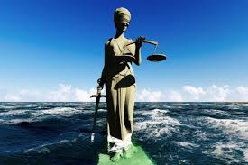 review  ethics in the real world  by peter singer   the bookslady justice statue sinking into sea water