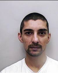 Ahmed Khan, 33, was caught by Cardiff Drug Squad officers with £6,000 worth of cocaine and £18,000 in cash, as well as scales and packaging material. - ahmed-khan-980563657