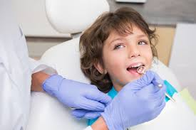 a second opinion dentistry for children pediatric dentist examining a little boys teeth