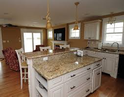beautiful traditional kitchen interior design using white cabinet made from wooden material completed with cream granite black color furniture office counter design