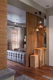 living room dividers ideas attractive: wood wall w built in seating and wood slat room dividers