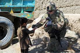 u s department of defense photo essay u s army spc brittany kabe right gives candy to a child in paktia