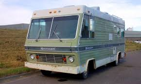 how to choose the right rv to live in for full time travelers photo by rl gnzlz an old boxy motorhome green paint on the sides large front windows on