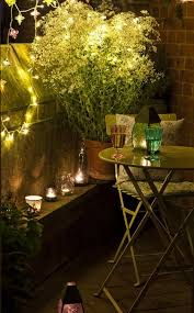 exterior romantic design for small balcony with beautiful lighting fixtures setting with nice round sleek table beautiful lighting fixtures