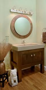 funky bathroom lights:  bathroom cute wall lighting idea also round framed mirror feat trendy powder room vanity design