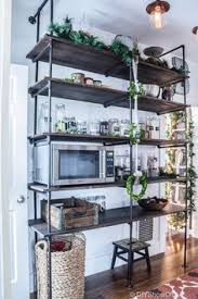 industrial open shelving for kitchen or any space love the use of it here build industrial furniture