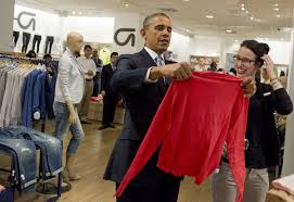 poll most in u s support higher minimum wage unless it costs president obama shops for clothing for his family alongside store employee susan panariello during a