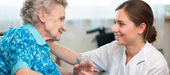 Image result for nurse with elderly patient in a house