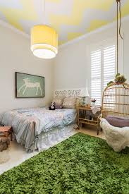 girls room playful bedroom furniture kids: playful kids bedroom with chevron ceiling and birdcage chair