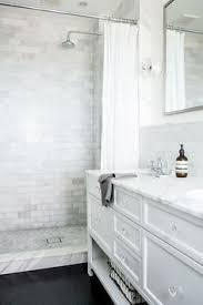 bathroom white tiles: we really like how the different shades of white and gray blend as well as complement