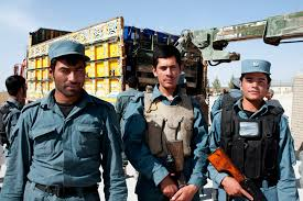 u s department of defense photo essay afghan policemen stand guard as voter registration papers are loaded onto a truck on camp eagle