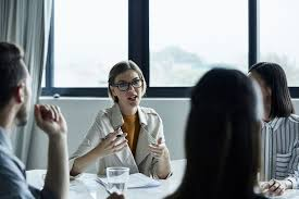 Businesswoman discussing plan  Morsa Images Getty Images The Balance
