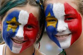 culture of acadia the canadian encyclopedia ten year old annie lyne leblanc left and her sister felicia 13 in the acadian colours of red white blue and yellow in bouctouche n b during national