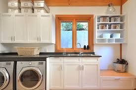 top load vs front load washing machine for a traditional laundry room with a white drawer beach style laundry room