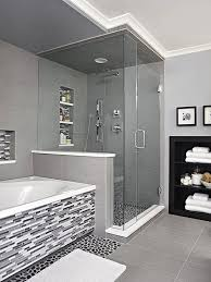 bath ideas: sheathed in oversize ceramic tile the shower is grounded with a textured river rock floor