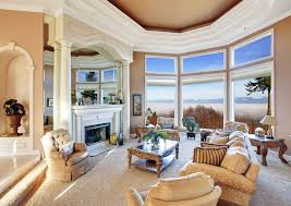 beautiful living room with pillar fireplace and mountain view beautiful living room