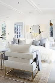 light and bright all white living room with touches of brass and dove gray beautiful white living room