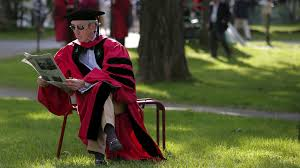 is grad school worth it quartz michael o leary professor of surgery at harvard medical school reads a newspaper