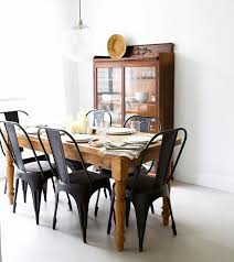 chair dining room tables rustic chairs: matte black chairs with a rustic wooden table from pineapple life via design